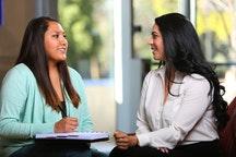 Adviser Myrna Cardenas converses with a student. Photo Credit: College Success Arizona