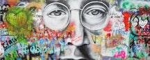 Graffiti wall with image of John Lennon