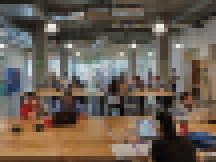 University of Utah students convene in the open-community innovation space on the ground floor of Neeleman Hangar at Lassonde Studios