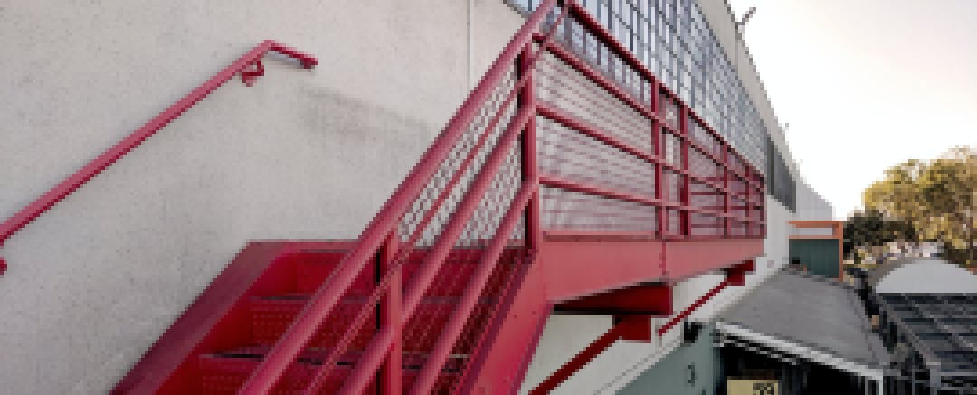 The red stairway leading to Gate 510, which houses this summer's PilotCity fellows