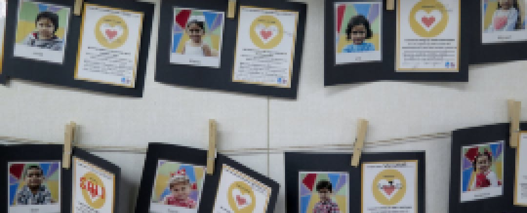 Parents write their commitments to their child, which is posted on classroom walls