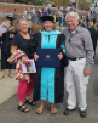 Morrison and her parents Pat and Sandy Koerner after her hooding ceremony at Montana State University in 2018.