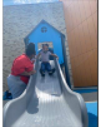 Teacher and child on the slide