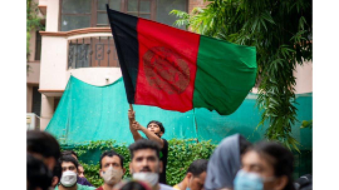 Afghan boy with flag